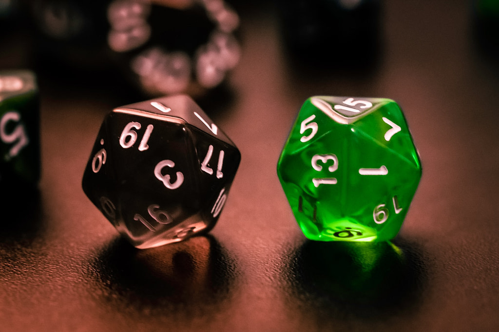 green and black dice on brown wooden table