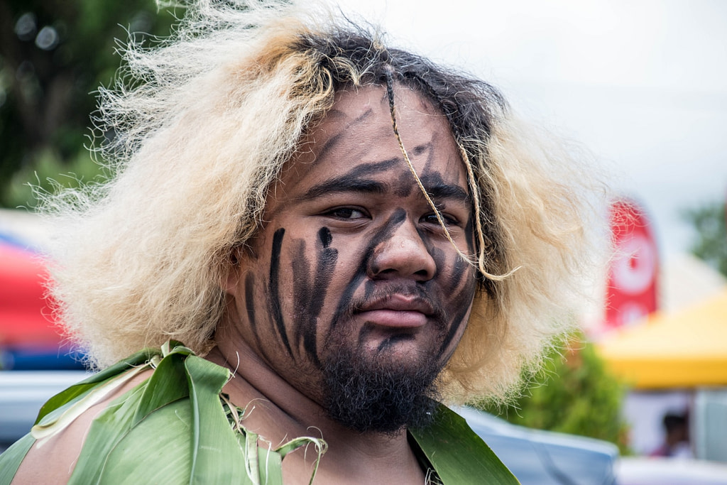 man with black face paint and blonde hair during daytime