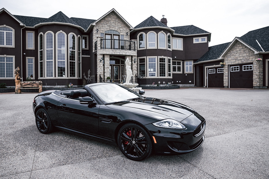 black convertible coupe parked near house